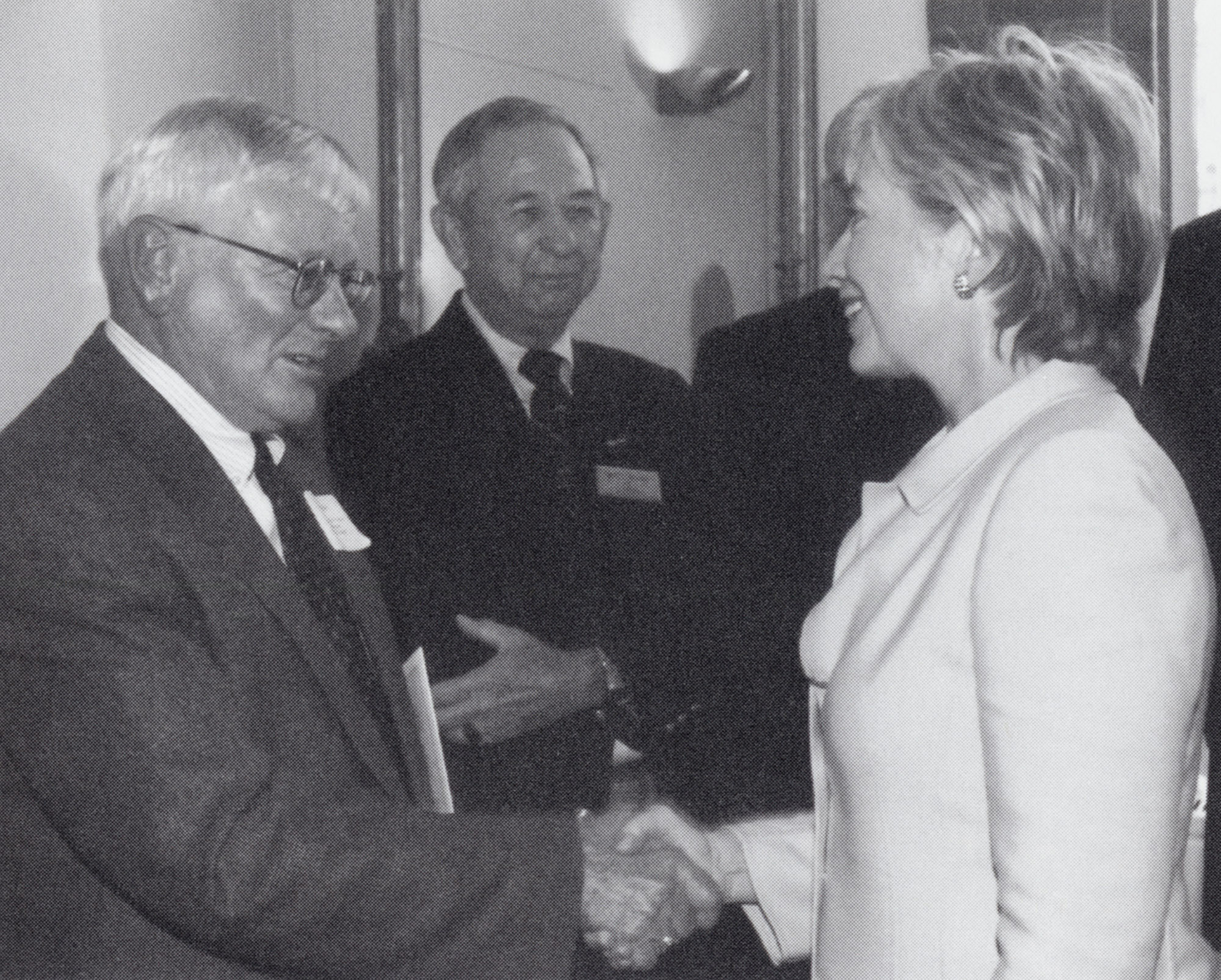 Hillary Clinton shaking hands with campus dignitaries