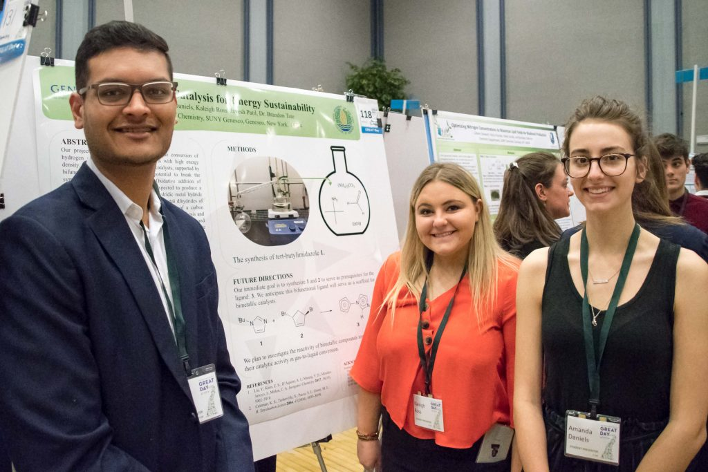 Jayesh, Kaleigh, and Amanda prepare to present their poster on the synthesis of bifunctional ligands.