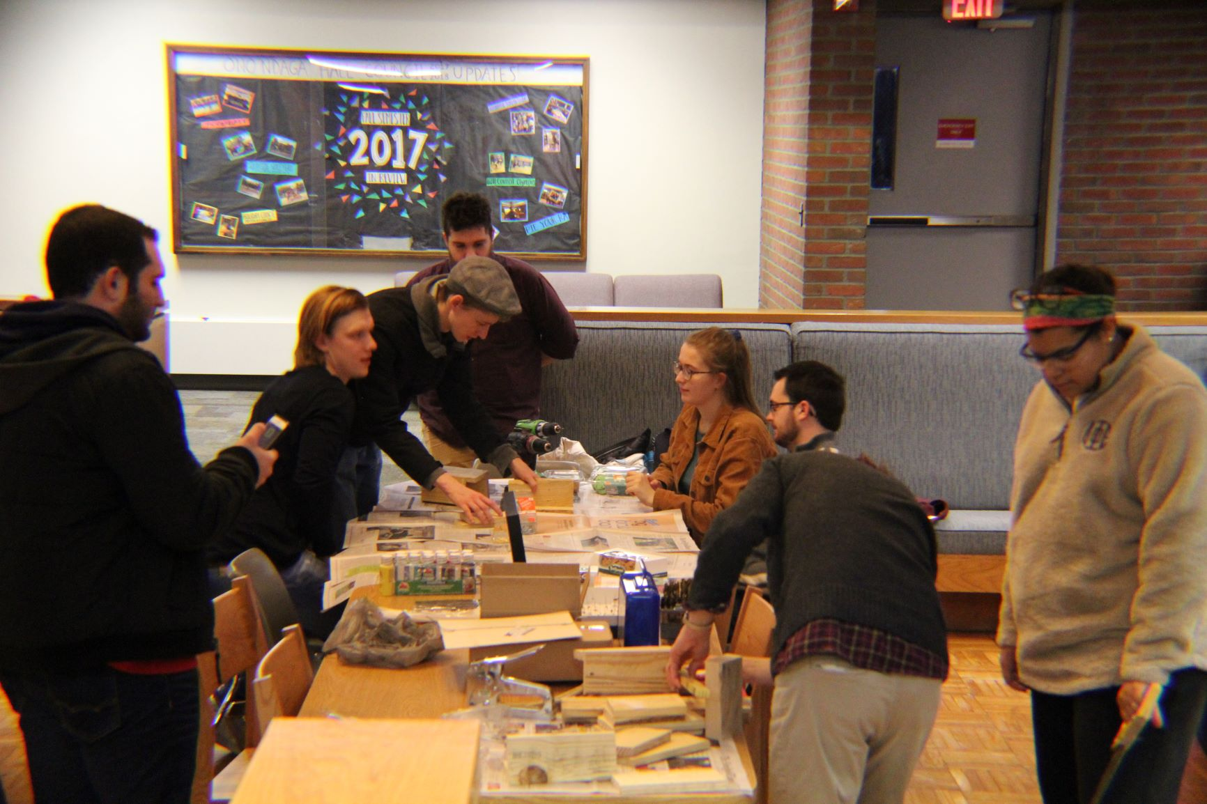 Members of the Arboretum Group work with students to create houses for bees