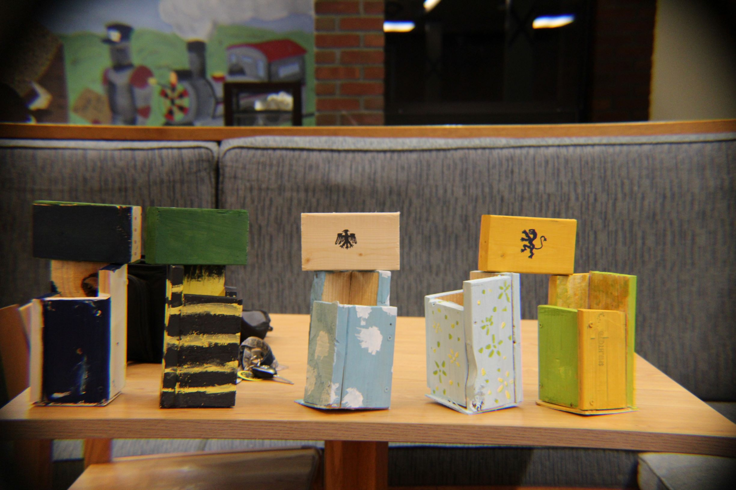 Student-constructed bee homes of various shapes, sizes and colors